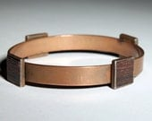 Mid century Minimalist Modernist copper bracelet adorned with four square laminated inlay