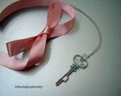 Key pendant necklace, the key to....