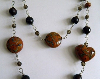 Garnet and smoky quartz with detailed lampwork beads - wire wrapped necklace in sterling silver