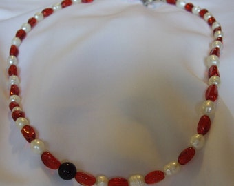 Red and white necklace.