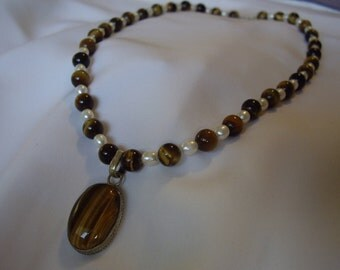 Tiger's eye pendant with pearls.