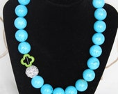 Blue Clover Necklace - Modern & Preppy.  Bright sky blue howlite stones accented with green clover and pave rhinestone bead.