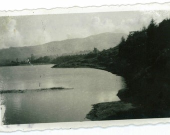 Vintage photograph: Lake surrounded by a forest and mountains