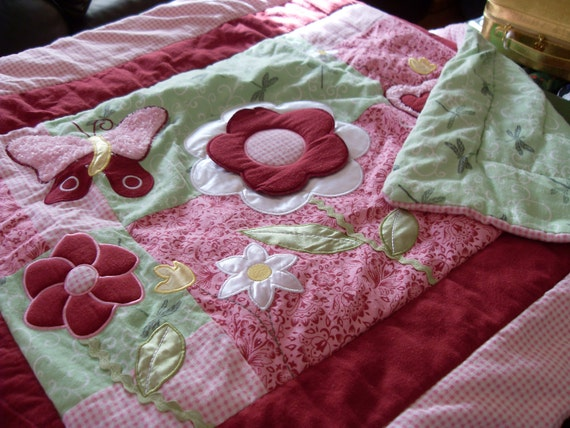 Butterfly and Flower Pink and Green Flannel Quilt.