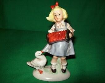 One (1), East German, Graefenthal Porcelain Figurine