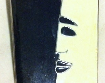 Black and white face pin