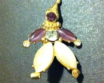 Purple and white clown brooch
