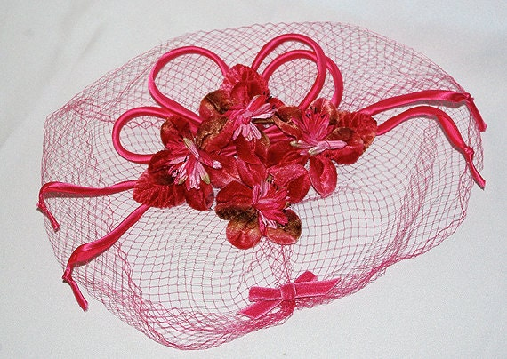 Vintage pink fascinator with flowers and birdcage veil
