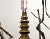 Hand-turned verawood ornament