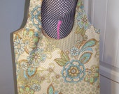 Tan, blue, green, brown floral knot tote purse.