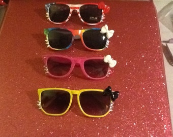 Pick 1 pair of hello kitty sunglasses