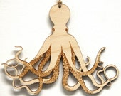 Whimsical octopus ornament from laser cut birch wood