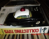 Police Car battery operated vintage toy (1950s). Made in Japan by Linemar