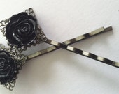 Sleek gunmetal colored heavy duty bobby pin with a sultry midnight black rose resin flower cabochon.