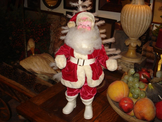 Darling 1950's Santa Clause, Dimensions: 15 and 1/4 inches height 7 inches width (longest width including arms)