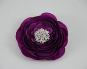 Purple flower clip w/jeweled center.