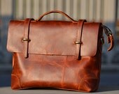 Hand-stitched Reddish Brown Unisex Leather Bag with a Adjustable Strap