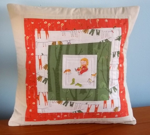 Modern patchwork quilted pillow cover in Heather Ross Far Far Away III fabric
