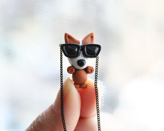Mocha the Pembroke Welsh Corgi with sunglasses necklace