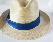 Straw Fedora Hat, with a hot blue ribbon with a metallic ring in between , great for spring and summer.