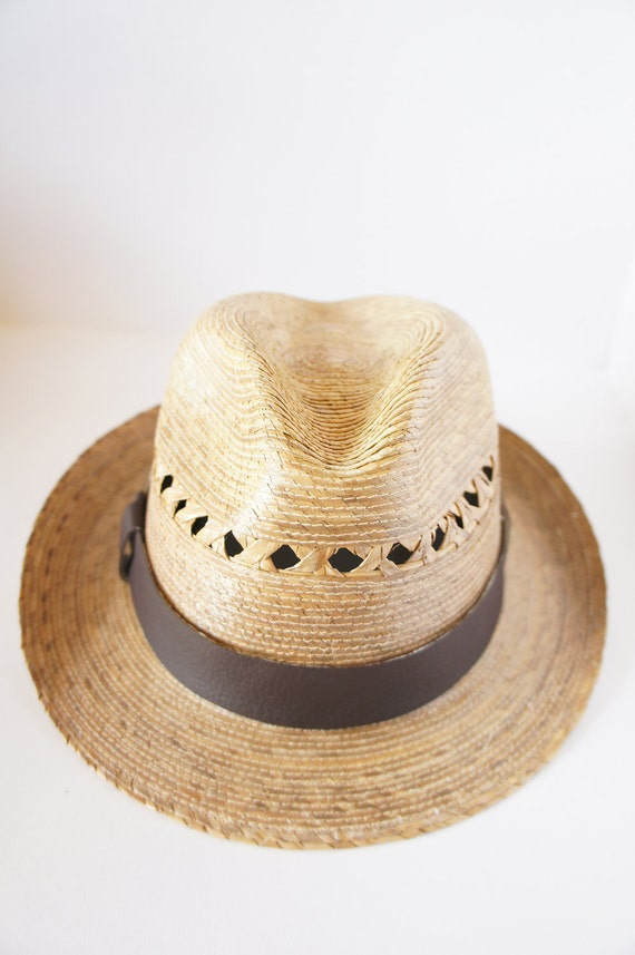 Straw Fedora Hat, with a Brown vinyl ribbon around and detail  by side, great for spring and summer.