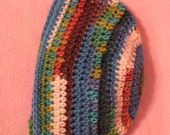 Multicolored adult beanie. Colors include white, rust, brown, turquoise, blue, and olive green.