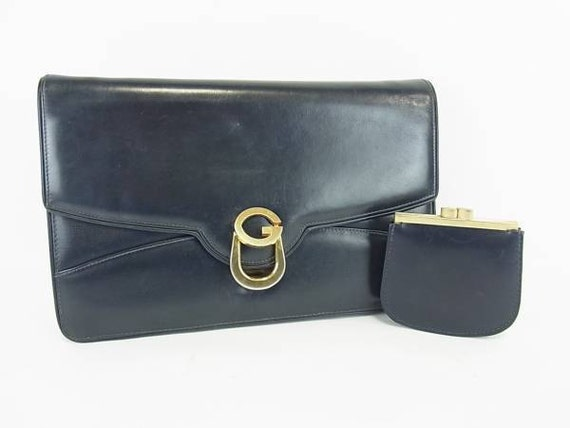 70s Vintage Gucci genuine leather clutch bag with matching coin purse. Great condtion