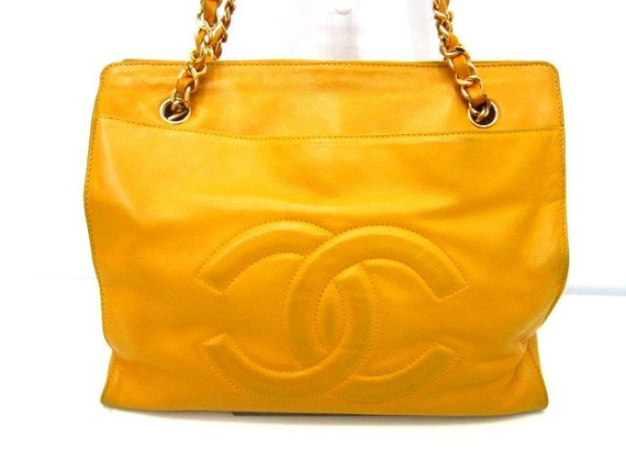 Vintage CHANEL calfskin Yellow tote with gold-tone chain handles. Lucky and good fortune color for you
