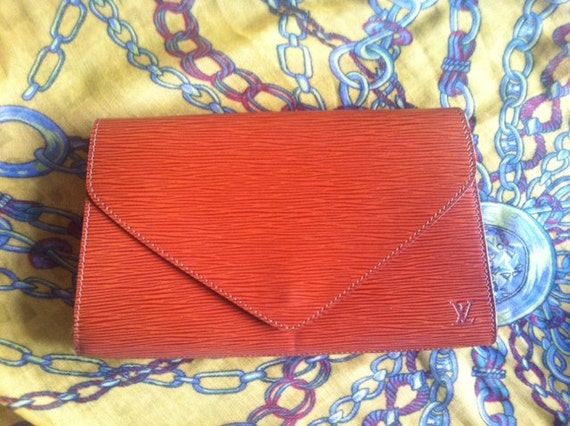 Vintage Louis Vuitton epi envelop style clutch with LV embossed. Trapezoidal shape