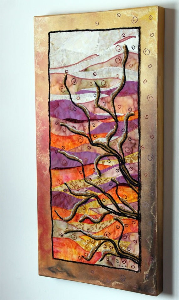 Tree branches with sunset and spirals: art quilt on painted canvas