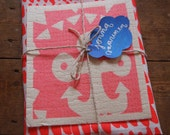 The 'Hundreds and Thousands' Tea towel and 'Anchor' Dishcloth bundle in pink and red