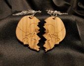 The Broken Skull Heart on walnut veneer and split into 2 each on a gun metal chain.
