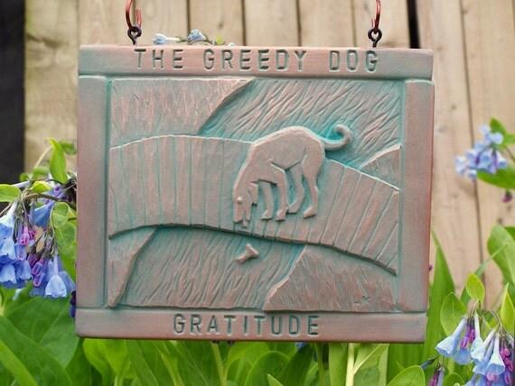 The Greedy Dog copper plaque