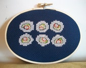 Sushi -- California Roll in cross stitch, six pieces on dark blue cloth, wooden hoop art