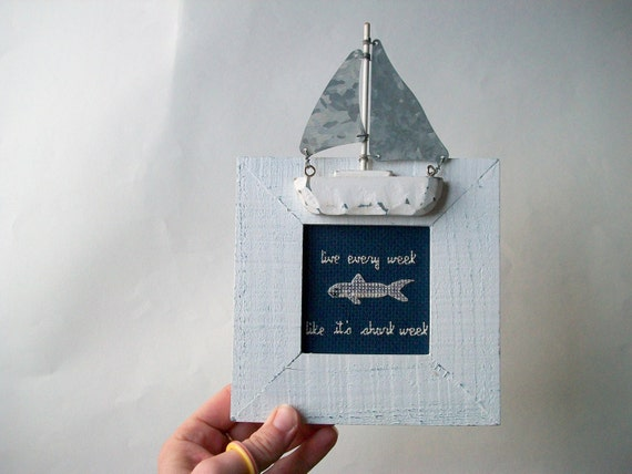 Live Every Week Like It's Shark Week cross stitch. In small sailboat frame, navy blue cloth, one of a kind.