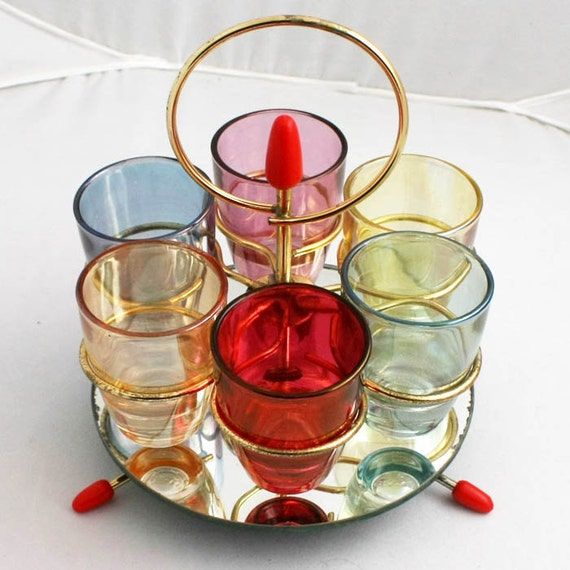 Vintage atomic shot glass holder and six coloured glasses  space age French glass