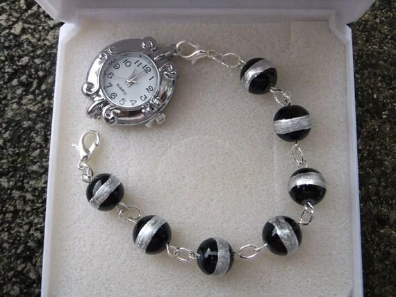 Ladies black and silver bracelet watch