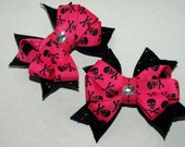 hot pink and black skull and cross bones pigtail bows