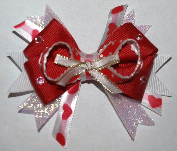 red and white heart bow