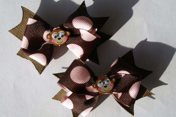 brown and pink monkey pigtail bows