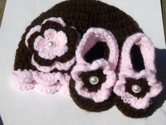 brown and pink crocheted hat and booties set with flowers