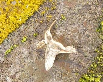 Brass hummingbird pendant