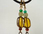 long dangle glass beaded with antique finish feather charms