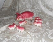 Vintage Porcelain Figurines - Sow with 6 little pigs on a chain