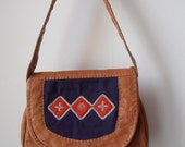 Hand made small  vintage leather bag from Lappland in Sweden.