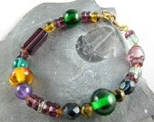 """Purple and Green Glass Bracelet with Gold Clasp    7 1/2"""""""