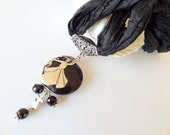 Onyx, silver-plated, black silk necklace whirling dervish
