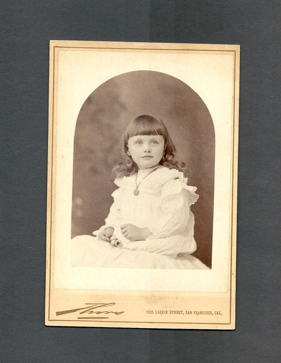 Cabinet Card of a Little Girl in White Holding a Rose