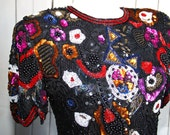 Beaded and sequined black DRESS decorated with modern shapes
