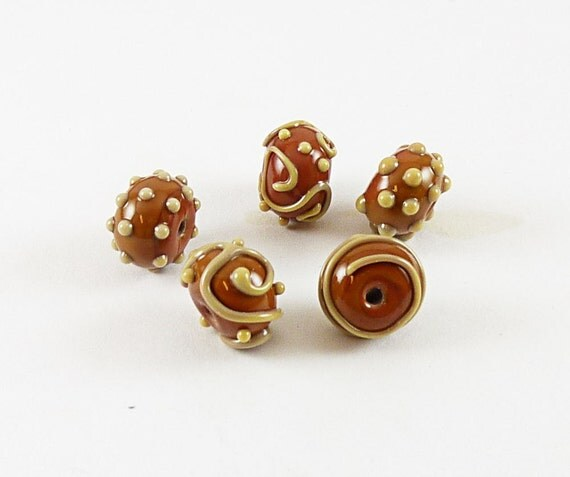 Lampwork glass beads in cinnamon decorated with dots, scrolls and swirls